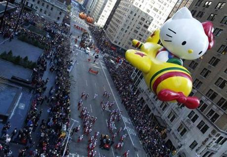 A Hello Kitty balloon float makes its way down 6th Avenue during the Macy's Thanksgiving Day Parade.