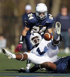 Westwood, MA - 11/22/2012 - Saint John's Jonathan Thomas #1 fumbles the ball in the 4th quarter. Behind him is Xaverian's Mike Brennan #24. Xaverian Brothers plays Saint John's Prep at Xaverian in Westwood, MA on Thursday, November 22, 2012. (Yoon S. Byun/Globe Staff) Slug: n/a Reporter: n/a LOID: 5.0.3836251216