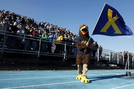 Westwood, MA - 11/22/2012 - The Xaverian Brothers mascot waves a flag during the game. Xaverian Brothers plays Saint John's Prep at Xaverian in Westwood, MA on Thursday, November 22, 2012. (Yoon S. Byun/Globe Staff) Slug: n/a Reporter: n/a LOID: 5.0.3836251216
