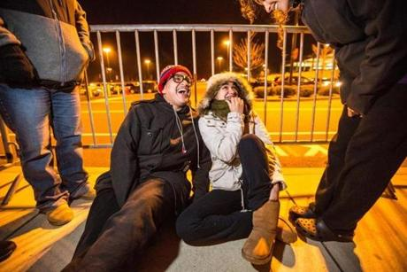 Elvis Ortiz (left), 19, of Hyde Park, and Andrea Hornedo, 16, of Hyde Park, wait outside Target at 1:00 a.m. to buy video games at South Shore Plaza.