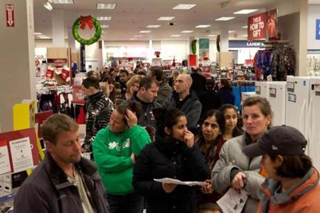 Shoppers inside Sears wait in line to buy products in a pre-black Friday sale. Approximately 400 people waited outside in line for the 8:00 p.m. opening of Sears at the Pheasant Lane Mall in Nashua, N.H. on Thanksgiving evening.