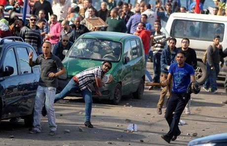 Protesters in Alexandria, Egypt, hurled stones at supporters of President Mohammad Morsi after the leader granted himself broad powers.