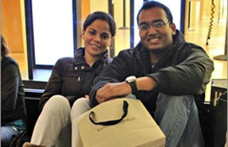 Guosimram Sidhu (left) and Anch Decai waited in line to save $100 on a MacBook Pro laptop at the Apple Store, after buying a $250 Xbox gaming system for $180 elsewhere earlier in the morning. The Xbox