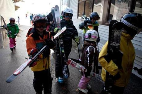 Snowboarders and skiers waited in line for the gondola up Exodus run.