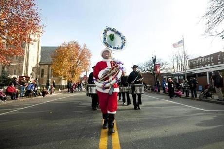 Nick King, dressed as Santa Claus, played the tuba during the Annual Christmas Parade in Quincy.