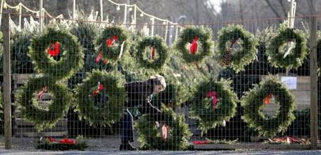 Phyllis Minehan was hidden behind wreaths she was hanging at a Christmas tree stand on Route 1 in Topsfield.