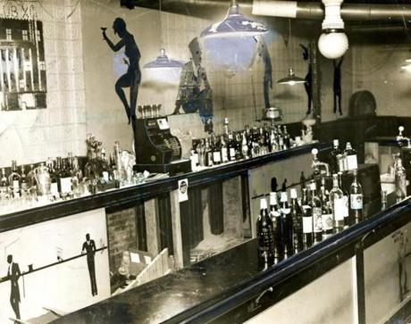 February 26, 1933: One of Boston's better known speakeasies in the North Station district. This one was raided and closed within two months after it opened. Most of the bottles in the picture are empty and are used merely as decoration.