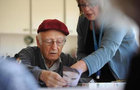 Intern Susan Garner-Titus helped resident Irving in a class called Glued Together.