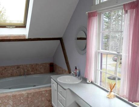 Off of the master bedroom is a bathroom with a whirlpool tub, separate shower, and double vanity sink.