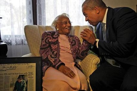 Governor Deval Patrick dropped by the home of 106-year-old voter Elizabeth Hinton to present her with a copy of The Boston Globe signed by Patrick and President Obama which lauded her for making it to the polls to vote.