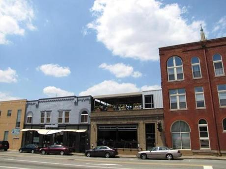 At the busy intersection of South Highland Avenue and Penn Circle South, near the Goodwill clothing store, the upscale restaurant Spoon (on right) and adjacent BRGR Bar (center) are owned by executive chef Brian Pekarcik, Pittsburgh Magazine's 2012 Chef of the Year.