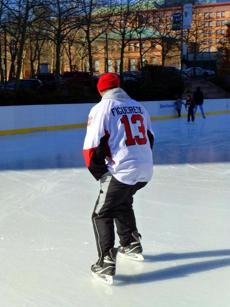 A skater wearing a Gansett Clams jersey practiced his form on the ice.
