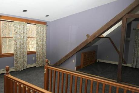 The house features a third-floor master suite with original exposed beams.