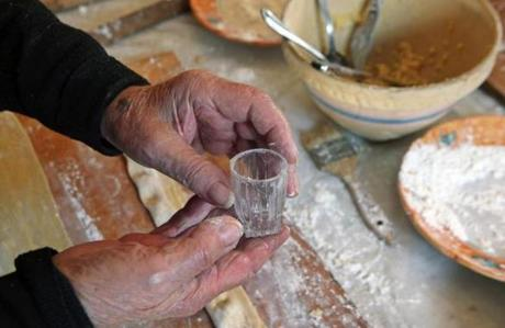 The shot glass - a family tradition - used to punch out the anolini shape.