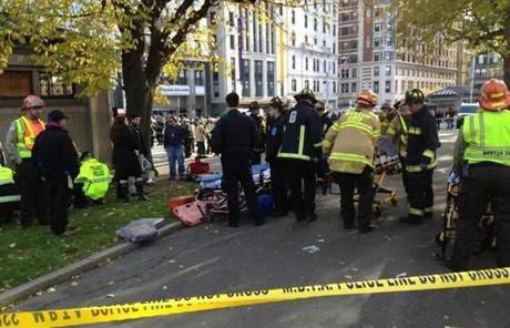 Emergency medical workers set up a triage operation on the sidewalk at the station to evaluate the passengers.