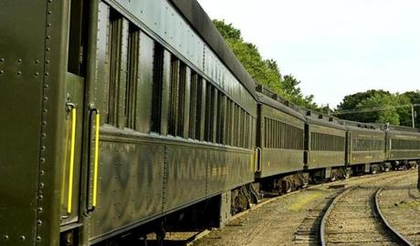 Restored coaches, used by the Essex Steam Train & Riverboat, line the tracks at the station.