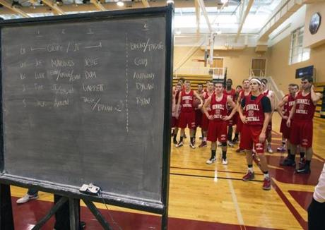 Grinnell's Jack Taylor and his teammates studied the blackboard at Darby Gym.