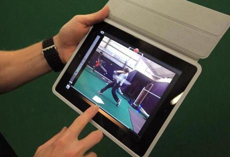 Antonelli uses an iPad to shoot video and then analyze a batter's swing at Route 1 SportsPlex in Danvers.