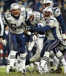 Tedy Bruschi, left, celebrated after making a key stop on fourth-and-1 in the fourth quarter.