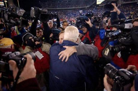 Bill Belichick and Cowboys head coach Bill Parcells embraced after the game.