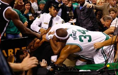 The fight spilled over into the first row of fans under the basket.