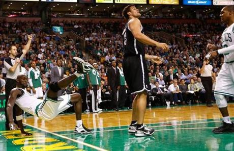 The fight stemmed from Rondo's reaction to a hard foul Brooklyn's Kris Humphries, center, committed on Kevin Garnett, left.
