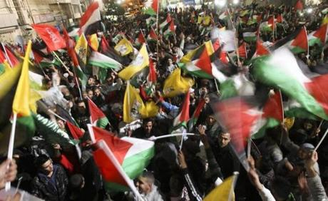 Palestinians waved their national flags as they celebrated.
