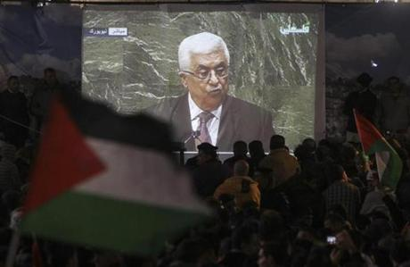 Palestinians watched on a screen as Palestinian National Authority President Mahmoud Abbas spoke at the UN.