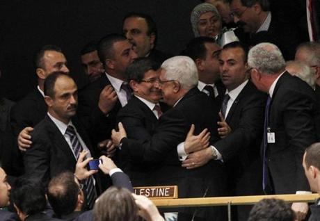 Abbas, center right, was embraced by the Turkish foreign minister after the vote.