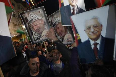 Palestinians waved posters of former Palestinian leader Yasser Arafat, left, and President Mahmoud Abbas, right.