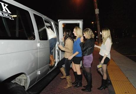 Framingham State University students board a shuttle on campus that will transport them to O'Connell's Pub on Worcester Street. O'Connell's offers the free shuttle to students from 9pm-1am on Thursday nights.
