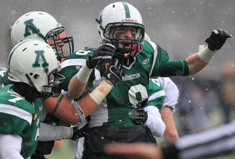 Abington's Joe Brady (8) celebrated a late game interception.