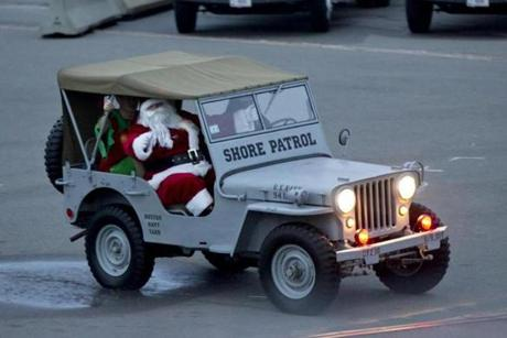 Charlestown, MA - 12/2/2012 - Santa Claus arrives by a Jeep to light the tree aboard the USS Constitution. USS Constitution sailors light the ship's Christmas tree in Charlestown, MA on Sunday, December 2, 2012. (Yoon S. Byun/Globe Staff) Slug: 03constitution Reporter: n/a LOID: 5.0.4002920530