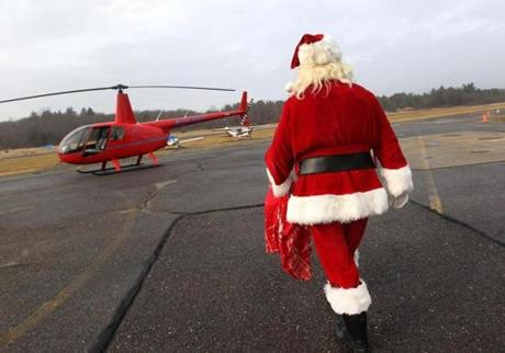 The Maynard parade Santa headed to Ellie Callahan's helicopter at Minute Man Airfield, on the way to the Maynard holiday parade.