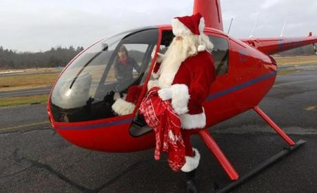 Ellie Callahan got the holicopter ready as the Maynard parade Santa squeezed in.