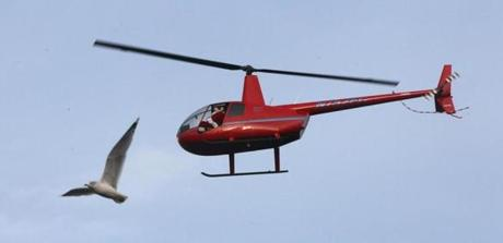 The helicopter ferried Santa Claus to the Maynard holiday parade.