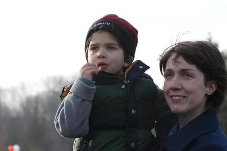 Elizabeth Albota and son Lucian watched as Santa arrived by helicopter.