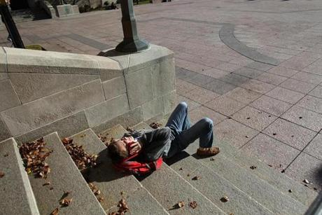 Noah Sparkman soaks in some warm  sun at Boston University while making a phone call.