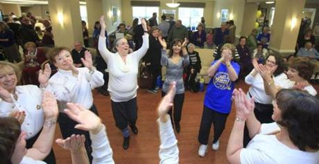 Peabody, MA - 12/02/2012 - Women participated in Israeli dancing during Latkepalooza. Hundreds of people, young and old alike, flocked to the Aviv Centers for Living in Peabody for