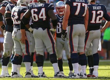 Welker waited in the huddle as the Patriots offense got into gear.