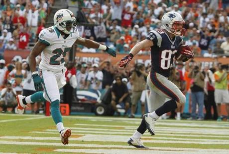 Welker ran through the end zone to score as Dolphins cornerback R.J. Stanford gave chase in the second quarter.