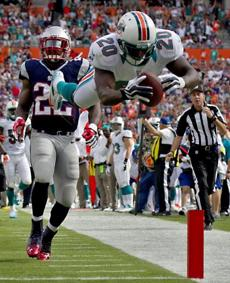 Dolphins safety Reshad Jones dived into the end zone after intercepting Brady in the first quarter, but the score was called back because of a penalty.