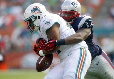 Dolphins fullback Jorvorskie Lane fumbled as he was tackled by Patriots linebacker Jerod Mayo during the first half.