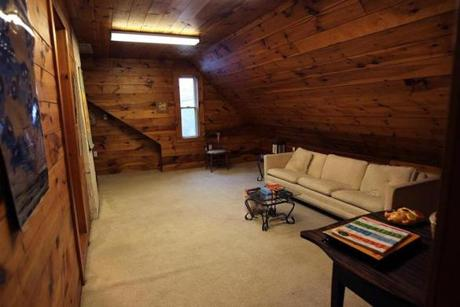 The attic studio has been turned into another floor of bedrooms, with a large playroom and the house's fourth bathroom.