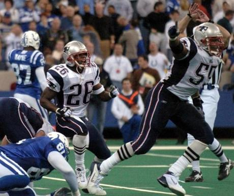 Willie McGinest, right, set off to celebrate after stopping James.