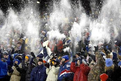 Fans launched snowballs into the air as they celebrated the Patriots' fourth-quarter touchdown.