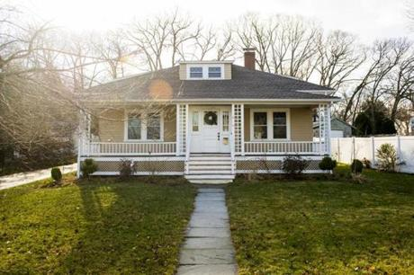 A broad farmer's porch provides a welcoming tone to this renovated bungalow.