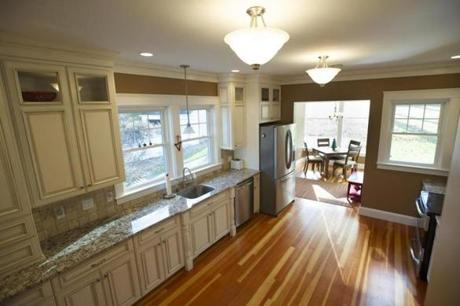 The rectangular kitchen has a breakfast nook.