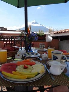 The roof deck of D'Leyenda Hotel in Antigua, looking out at Agua Volcano.
