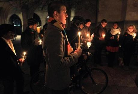 Boston University students, passersby, and others gathered on Marsh Plaza in front of Marsh Chapel for a candlelight vigil to remember and draw attention to the death of a BU graduate student bicyclist who was killed in a collision with a tractor-trailer truck at the intersection of Commonwealth Avenue and St. Paul street. The victim was the fifth bicyclist killed in a crash in Boston this year.